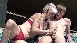 Kinky Granny In Thongs Sucks A Big Hard Penis Of One Young Guy
