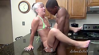 Mature Woman Is Kneeling On The Floor, In Her Kitchen And Sucking A Younger Guys Dick