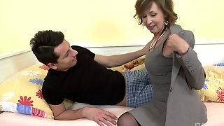 Fucking On The Bed Between A Mature And Her Younger Lover