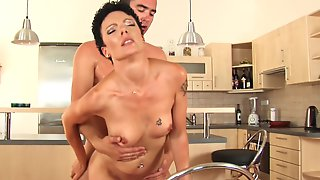 Kitchen Sex Between A Skinny Milf And Her Bf