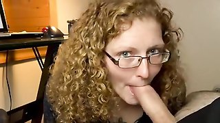 Nerdy Amateur Woman With Glasses Is Stuffing Her Mouth With A Long Cock