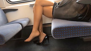 Lady With Sexy Legs In Heels On The Train