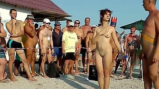 Naked Women And Men Are Having Fun At Neptune Nudist Beach