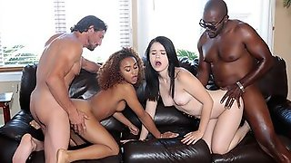 Black And White Couples Are In The Middle Of A Passionate Swapping Foursome