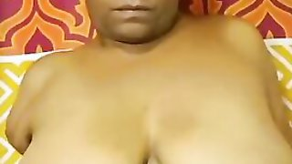 Chubby Black Woman Plays With Her Big Saggy Tits On The Camera