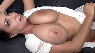 Big-titted Brunette Beauty Exposing Her Massive Knockers