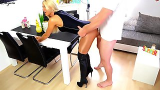 Weenie Loving Blond In Boots With High Heels Is Kneeling On The Floor Whilst Awaiting A Facial