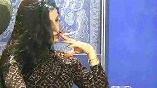 Dark Haired Girl Smoking