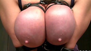 Giant Bazookas Golden-haired In Corset Rides Sybian