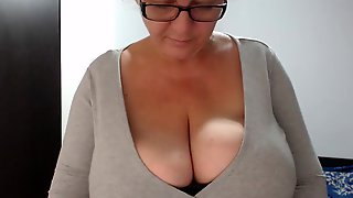 Busty Cougar Is Teasing Men With Her Huge Boobs