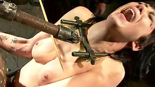 Hot Brunette Girl Tortured And Fucked By A Machine At The Same Time