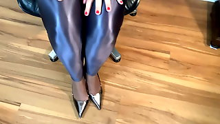 Silver Sling Pumps And Spandex Leggings