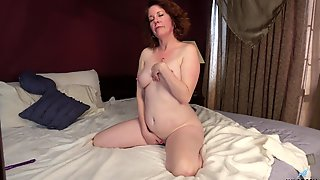 Bolder Older Charli Hope Pleasuring Her Hungry Cunt On The Bed