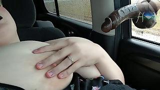 BBW Fucking A Large Ebony Fake Penis In The Car