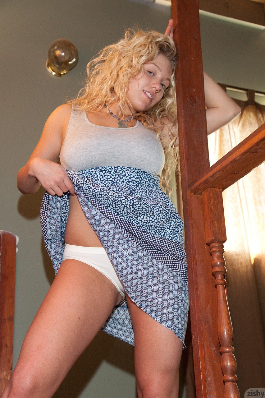 Exotic teen Emily R flashes her panties on the stairs flaunts her sexy rack