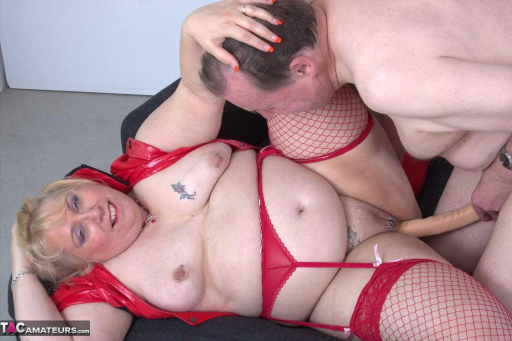 Older fatty Lexie Cummings has her pierced pussy toyed by her naked husband