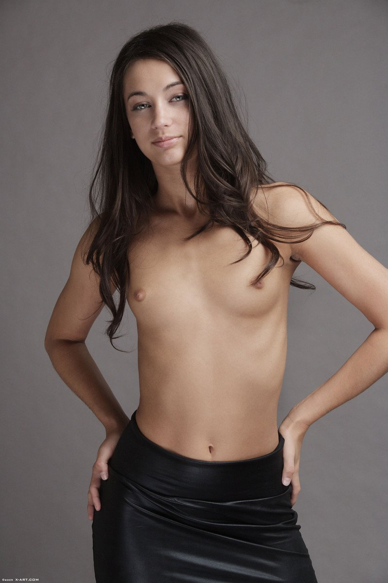 Slender Georgia poses with tiny tits bare before shedding her leather skirt