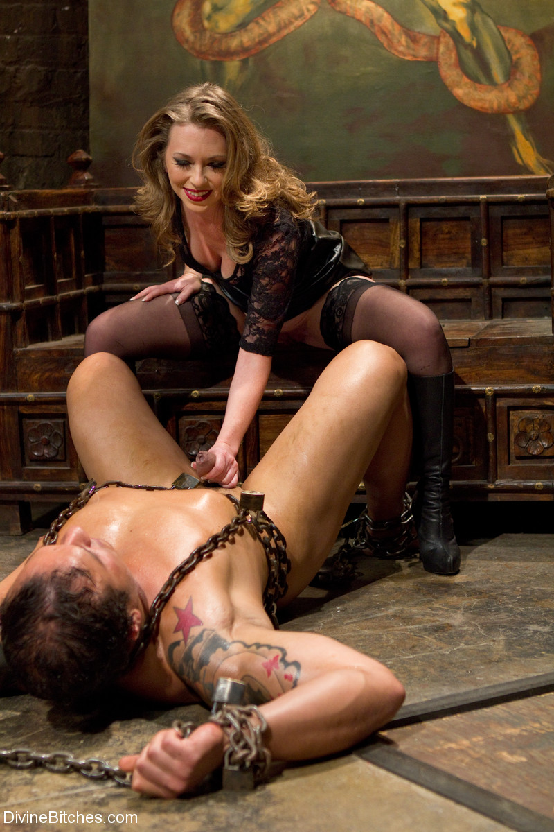 Wild Mistress T pisses in her slave's mouth before spanking his round ass