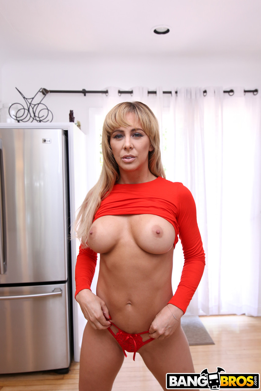Stunning MILF Cherie Deville poses in red lingerie and shows her perfect ass
