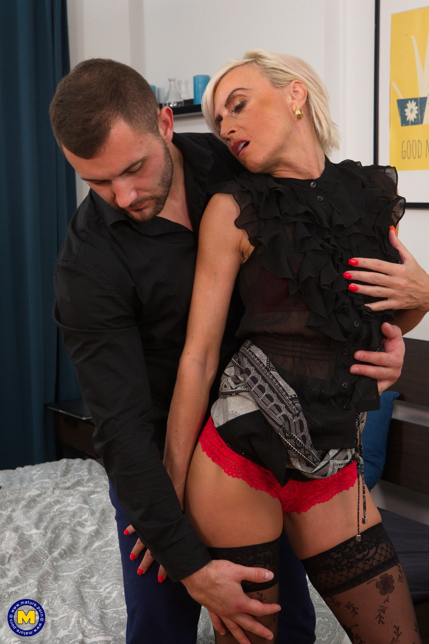 Older blonde woman sports a cum coated tongue after sex with a young man