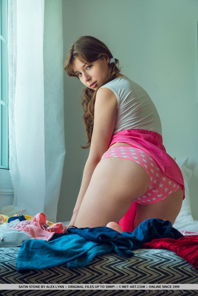 Sweet teen Satin Stone strips totally naked with her hair in pigtails