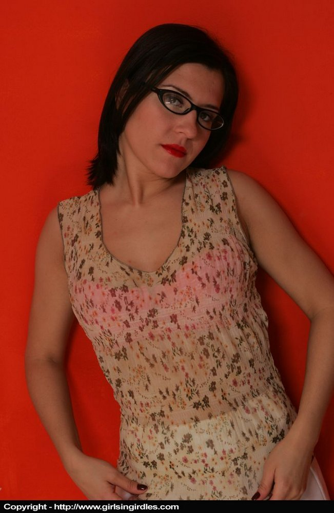 Brunette amateur sports red lips and glasses while exposing herself in nylons