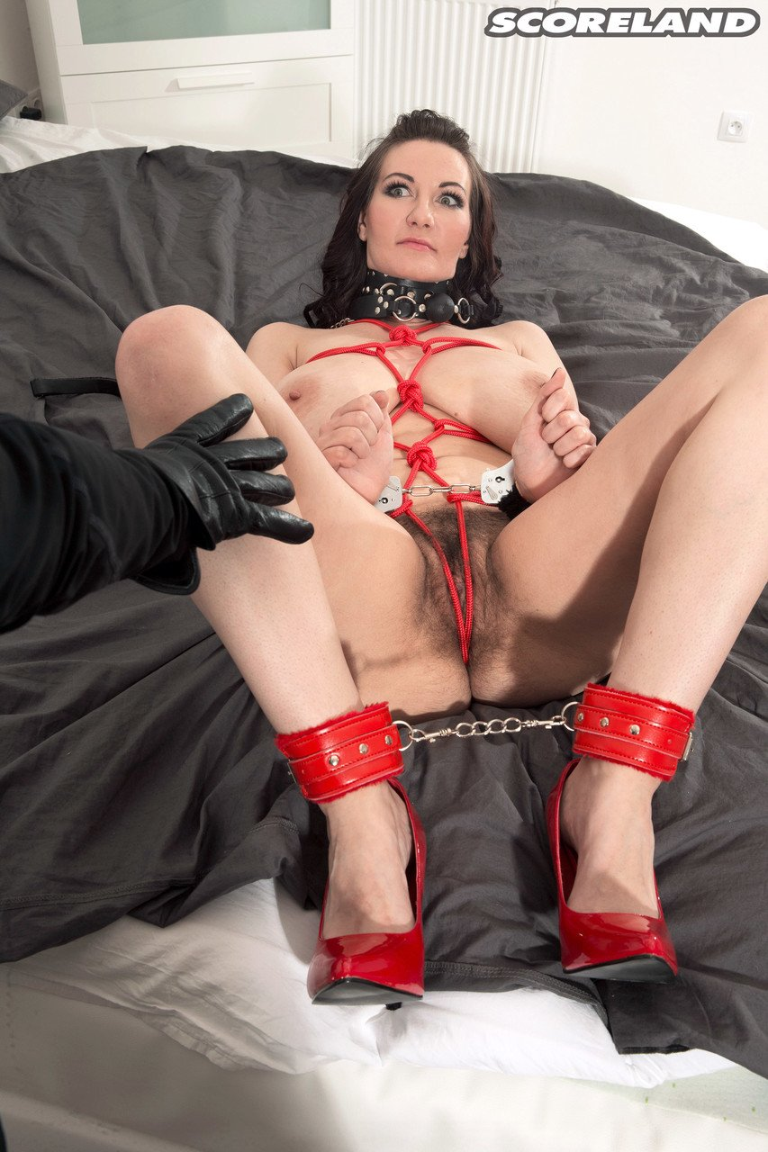 Busty brunette Vanessa Y big tits rope bound spreads hairy twat in red heels
