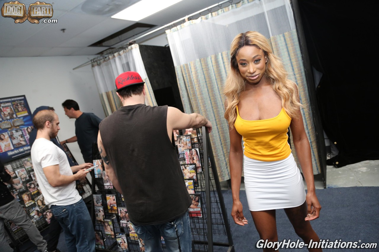 Busty black girl drips cum from her face after a blowbang in an XXX rated shop