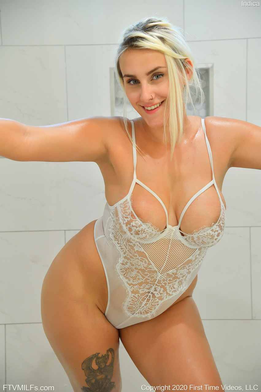 Busty blonde Indica works free of her lingerie while taking a shower