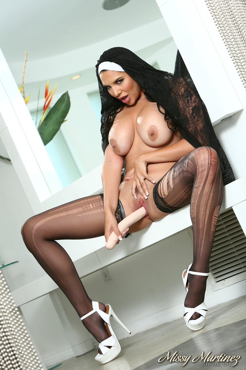Latina nun with big tits Missy Martinez sticks a rubber toy in her cunt