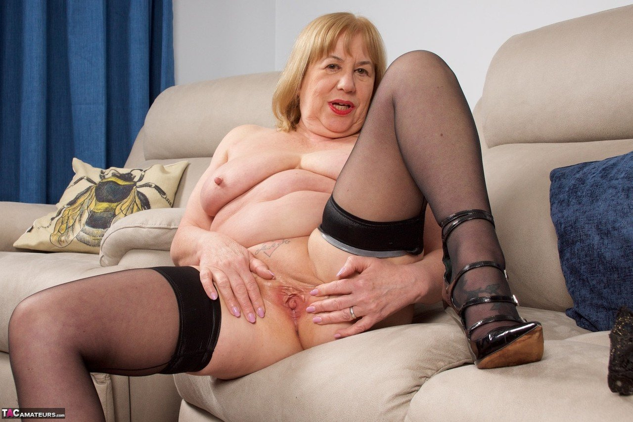 Older British woman Speedy Bee fingers her cunt after getting naked in hosiery