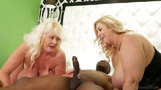 Lila Lovely and Kayla Kleevage are sharing a horny, black guy, during a very casual threesome
