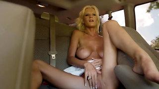 A hot soccer mom has fantastic sex in the van