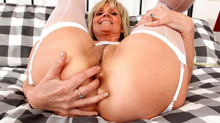 English GILF Dolly toys her pussy and fingers her ass