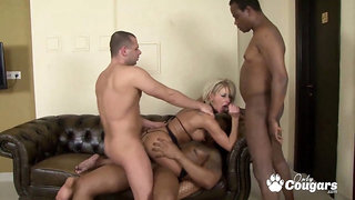 Milf gets group-fucked in all her holes