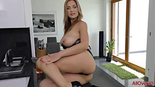 Big tited milf in high heels, Carol Gold is lying on the kitchen table and rubbing her cunt