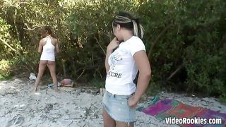 Two big boobed girls getting naughty on the beach
