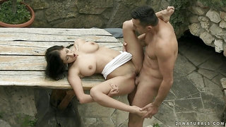 Picnic table sex with a big titty chick