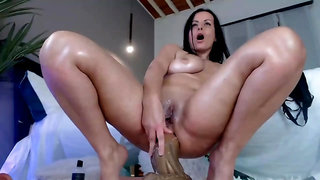 Lush dark-haired with huge, saggy mounds luvs how a giant fake penis senses when inwards her donk