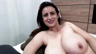 Spanish Megan sits around so we can admire her huge juggs