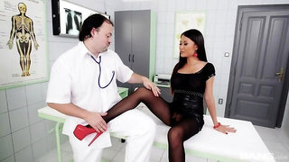 Pussykat rubs her stocking covered feet all over her doctors stiff dick