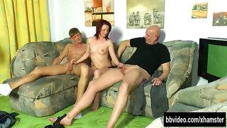 Slim redhead gets two dicks