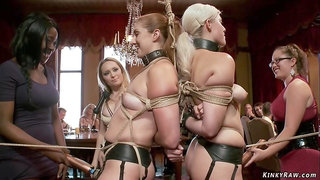 Slaves bound back to back at party