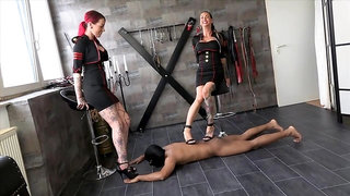 2 Ladys Trampling Slave's back in Heels