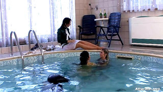 Fully dressed three lesbians in the pool