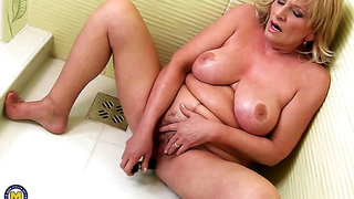 Naughty older lady playing with her toys