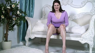 Brianna Green strips and unwinds on white chair