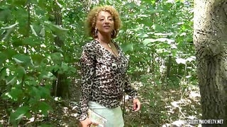 Black woman with curly, blonde hair, Sonia is sucking a stranger's cock while playing with her boobs
