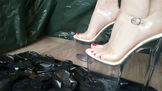 Lady L crush plastic with sexy black extreme high heels .