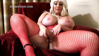Big ass blonde in erotic, red fishnets, Stassi Rossi is fucking a fake Santa in her bedroom